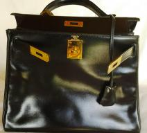 Hermès Kelly bag, 28 cm, black / gold, with lock and keys, dust bag. Very good condition